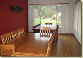 There is a large separate dining room with polished floorboards.
